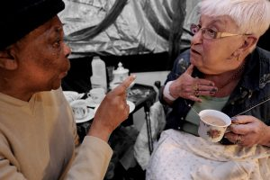 two older women talking over tea