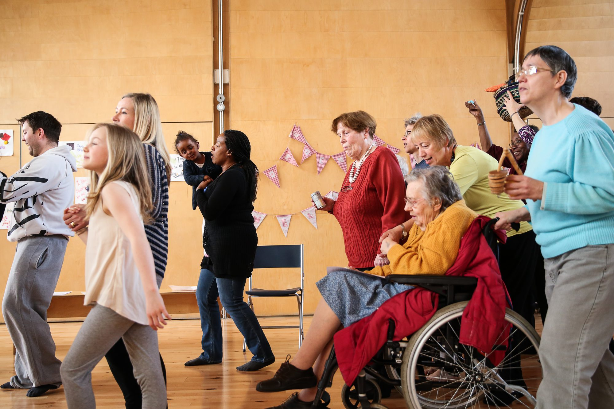 younger and older participants moving in one direction in a hall