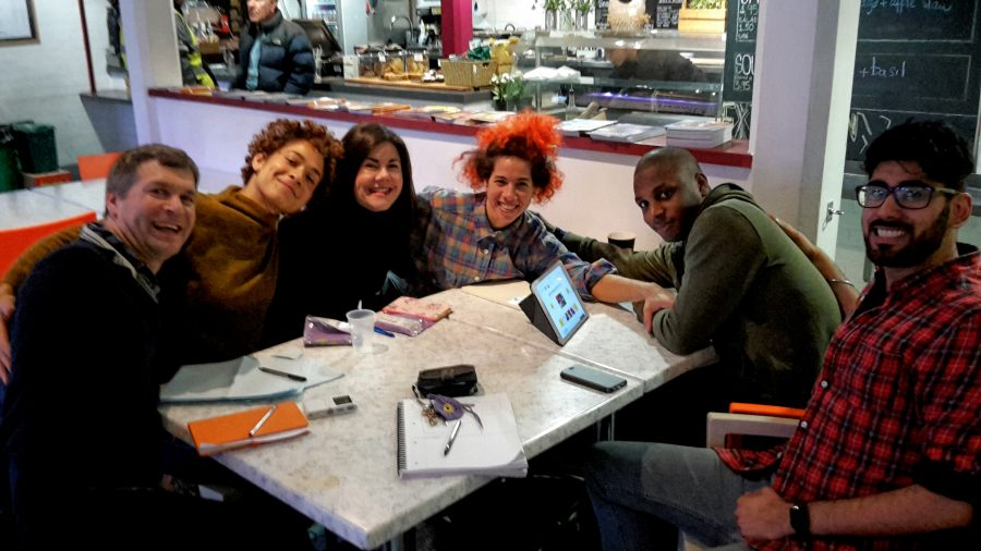Artsits sitting around table talking