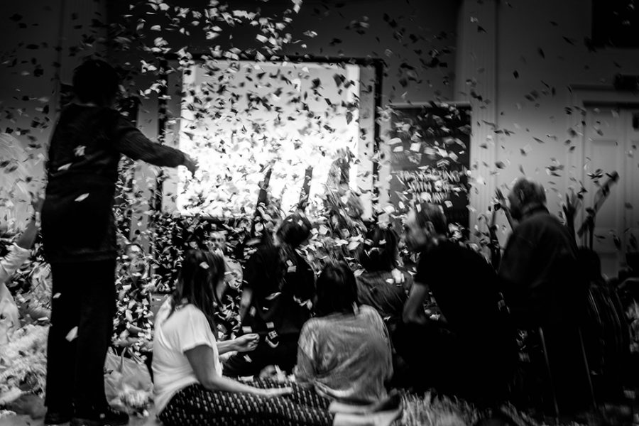 black white image confetti falling over seated participants