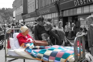 woman in bed in town centre