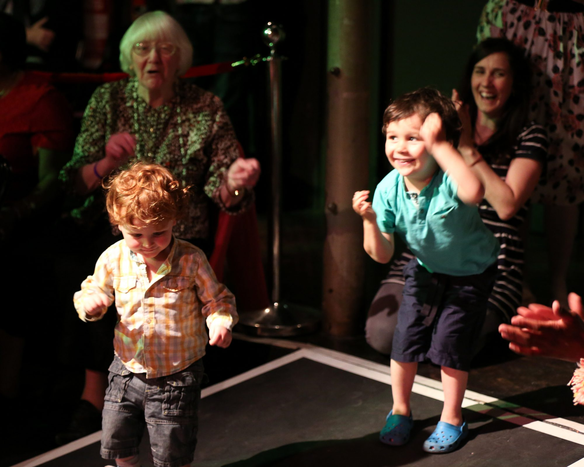 Children and older people dancing