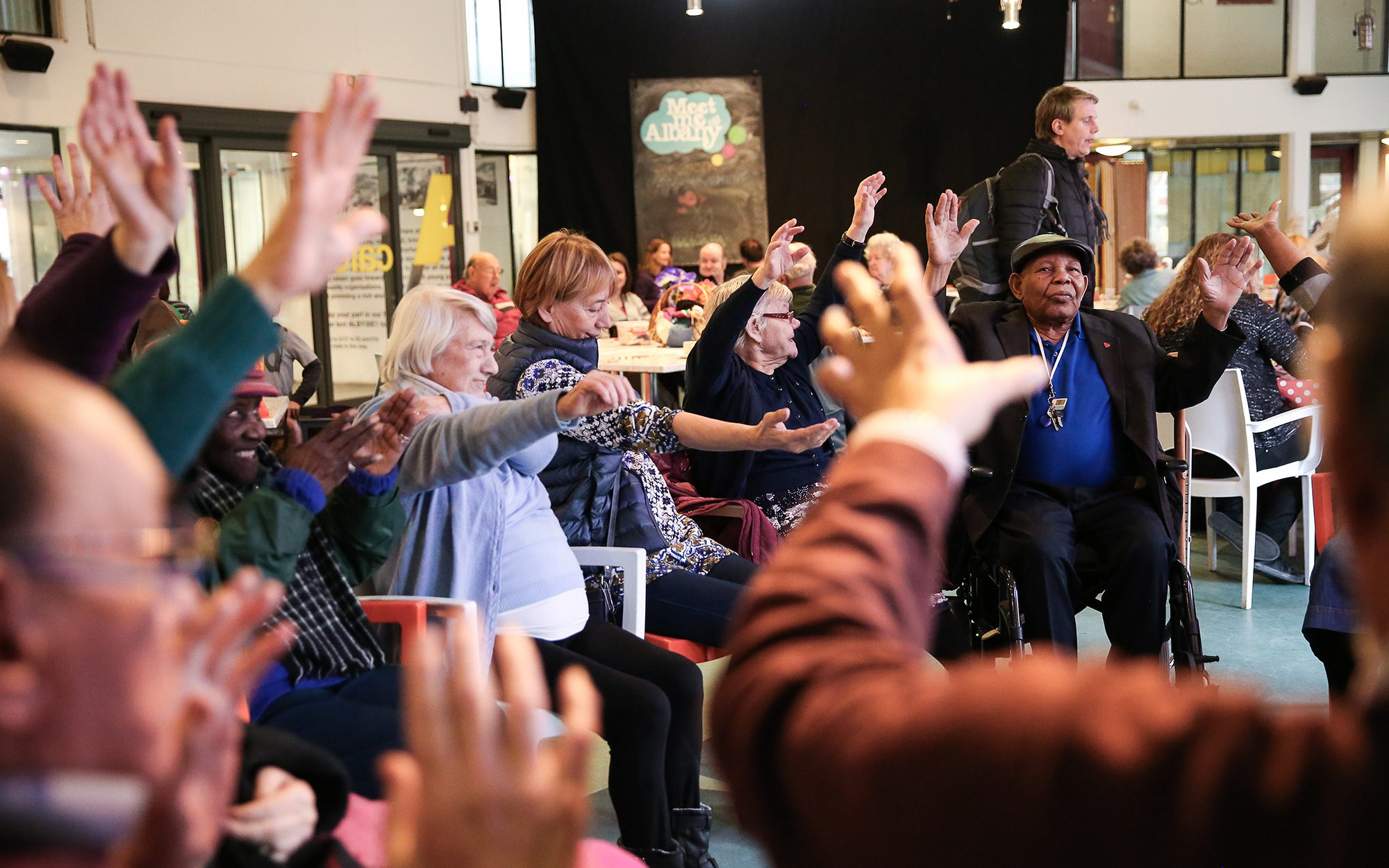 group of Older people waving arms around