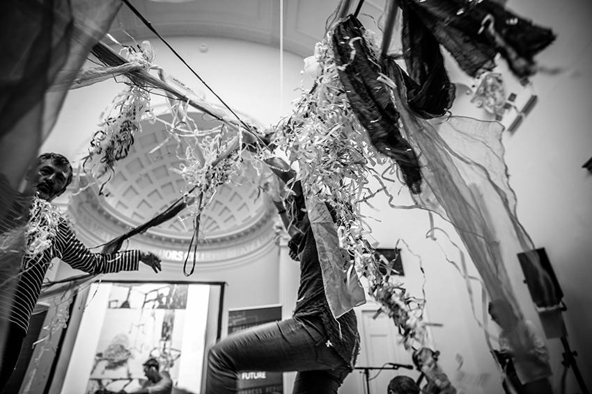 large woolen spiderwebs with people interacting