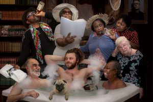 5 elders and 2 men in a tub with bubbles