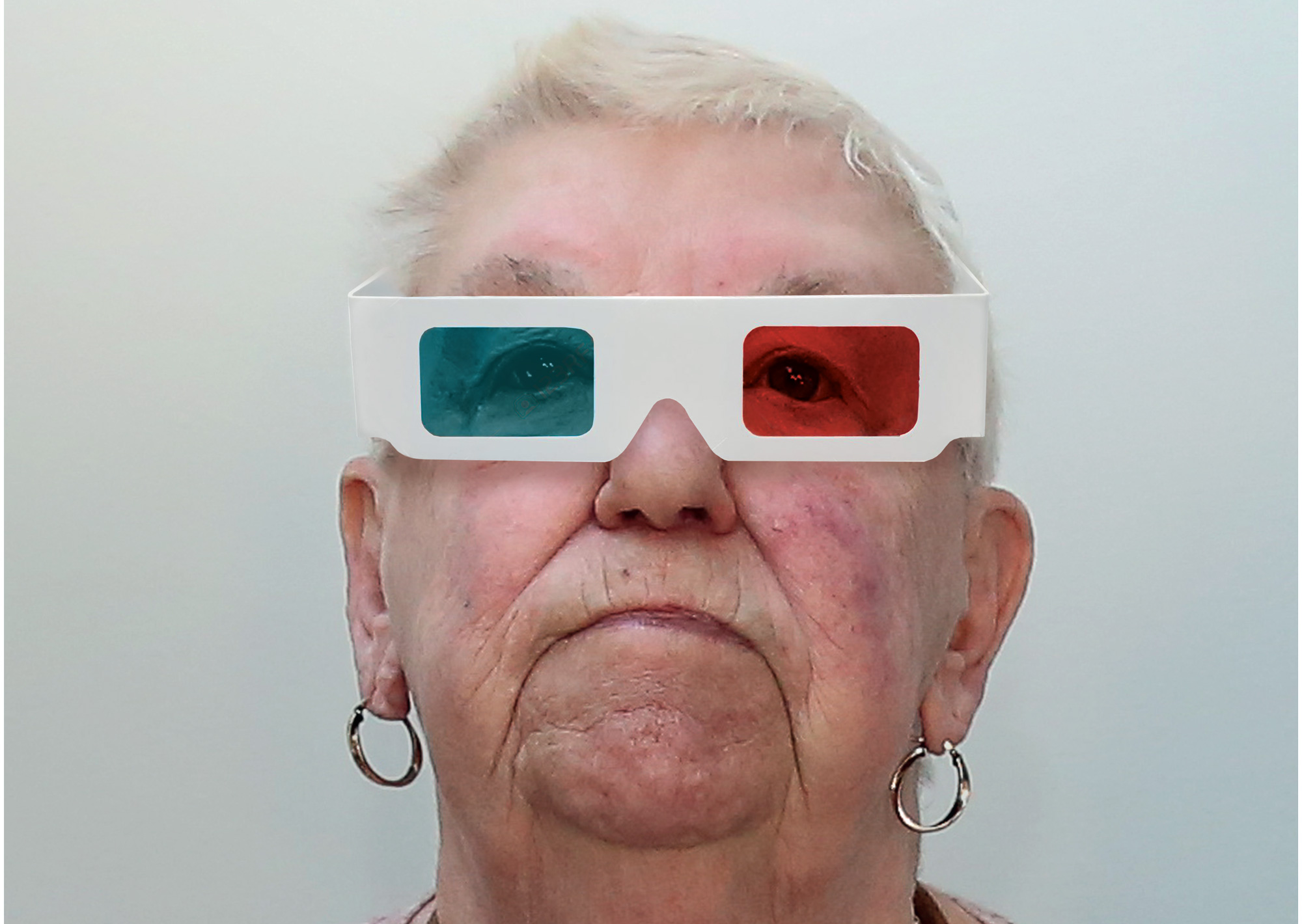older woman with 3D folm glasses on