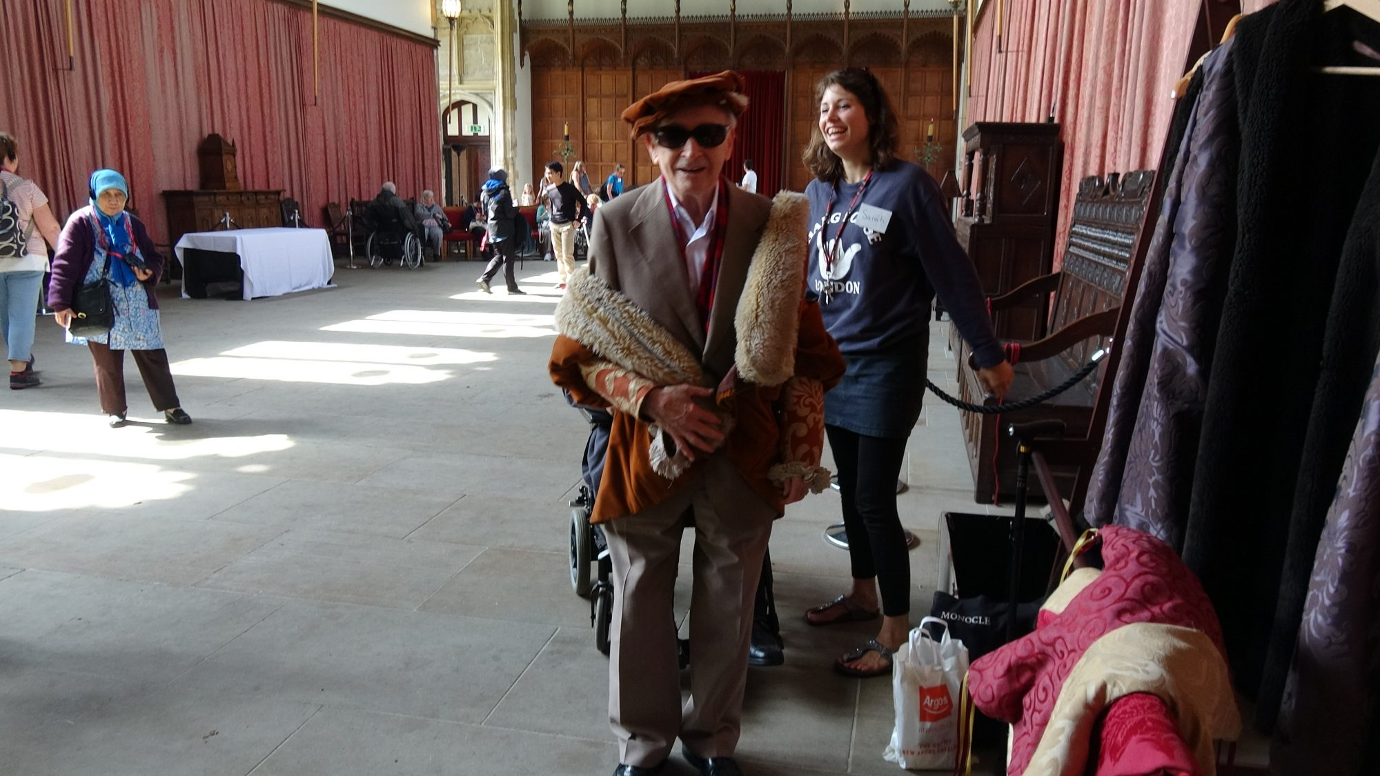 Man dressed up in historical clothing with sunglasses in a big hall