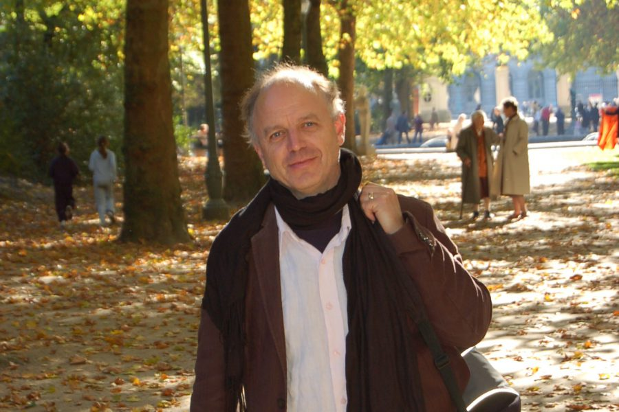 David standing in a park smiling