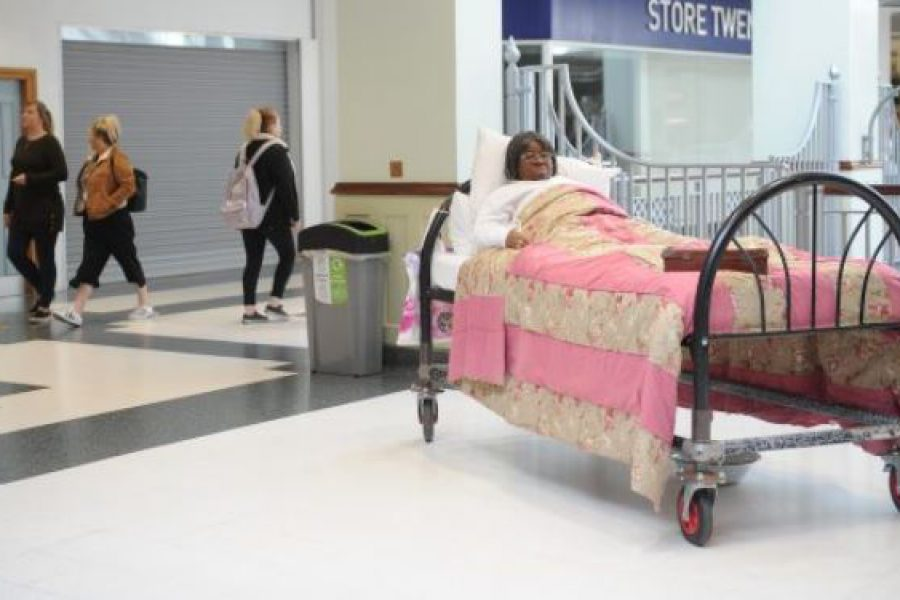 Actor in Bed in shopping centre
