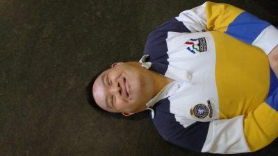 man laying on floor smiling