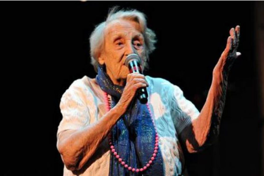 Older woman singing with microphone