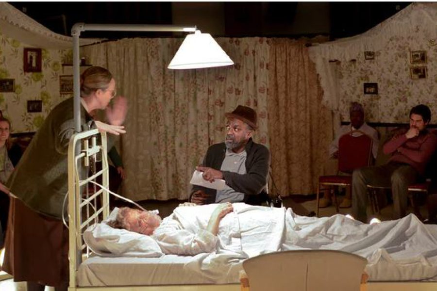 Bed with lamp over it people talking