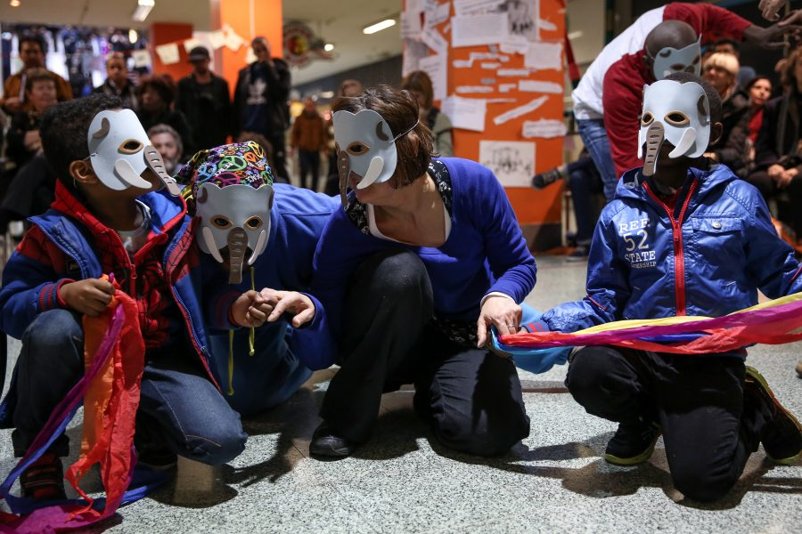 group of young children in masks