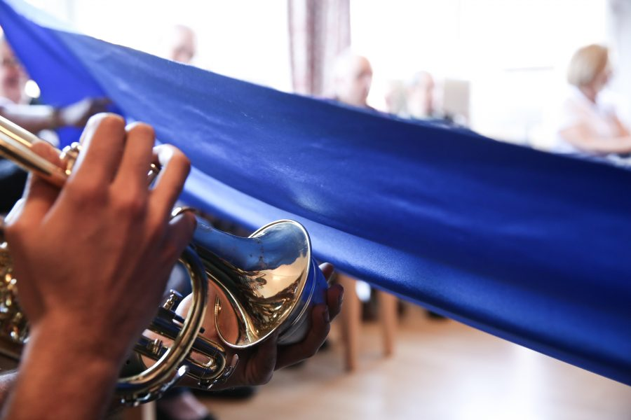 trumpet and blue fabric