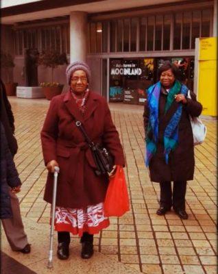 Two women standing in street
