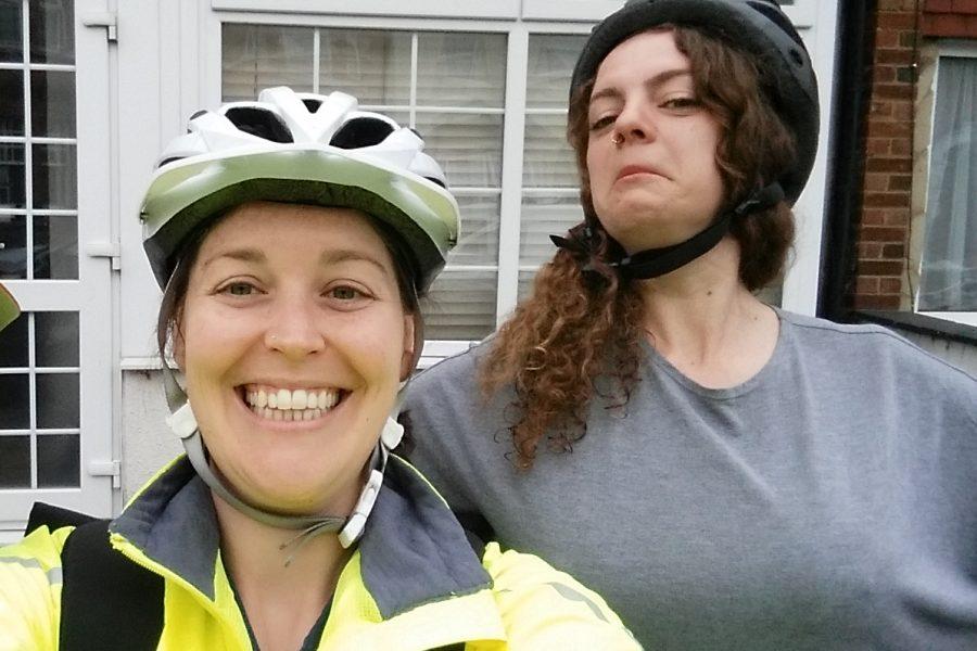 two women in cycling helmets