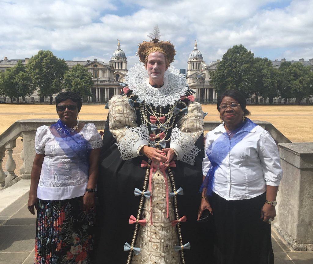 Man dressed as Elizabeth I and 2 women