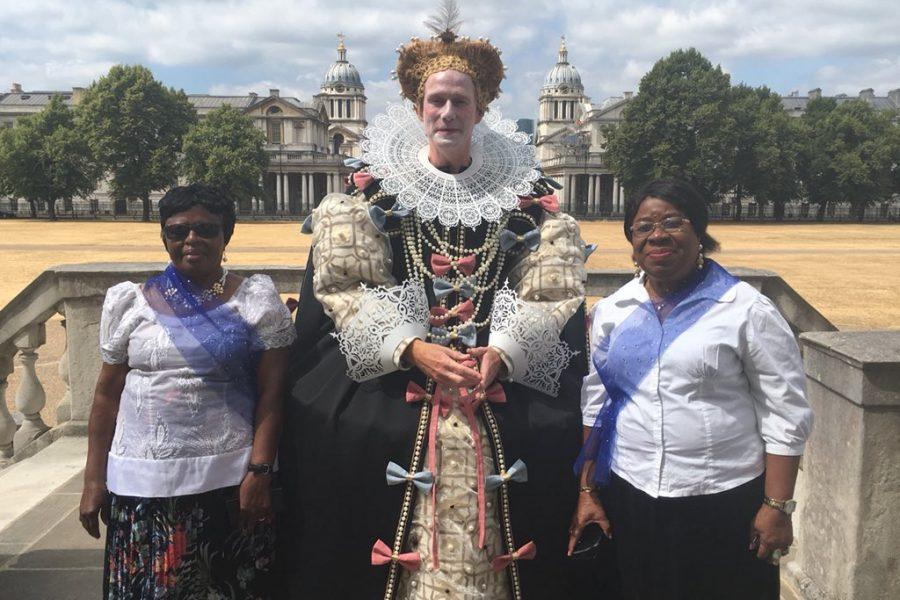 Man dressed as Elizabeth I and 2 women