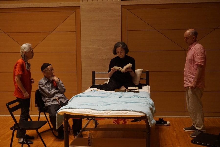 actor in a bed with director standing