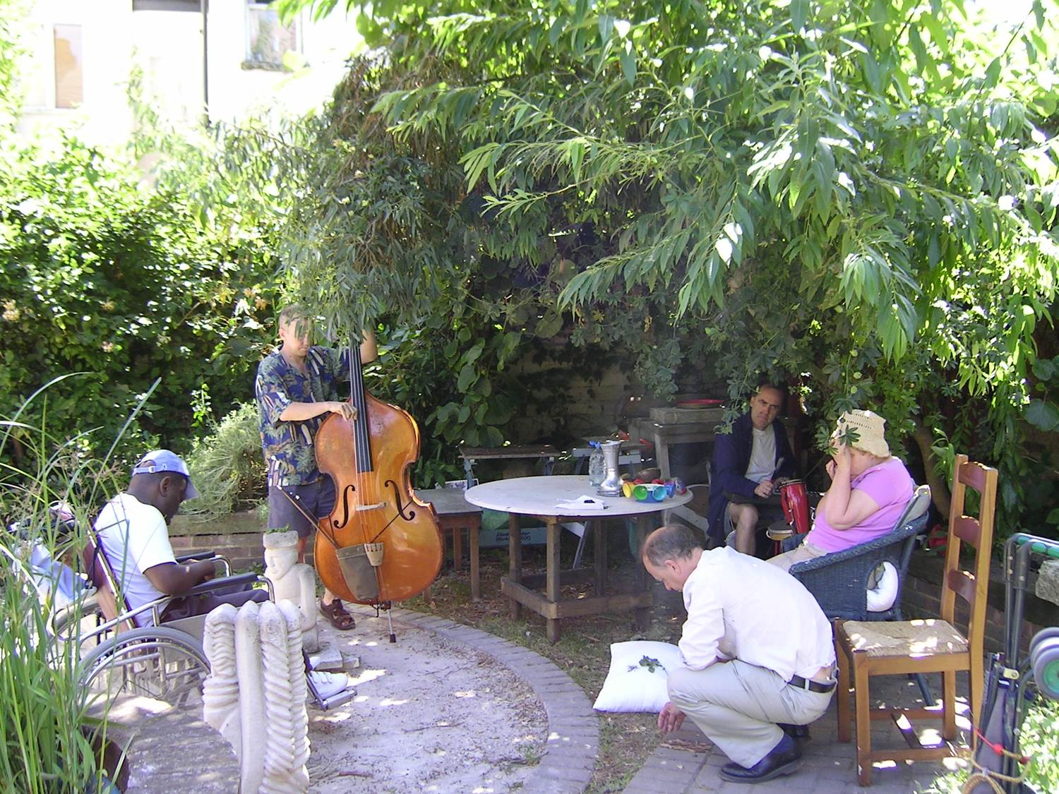 bass player and people in a garden together