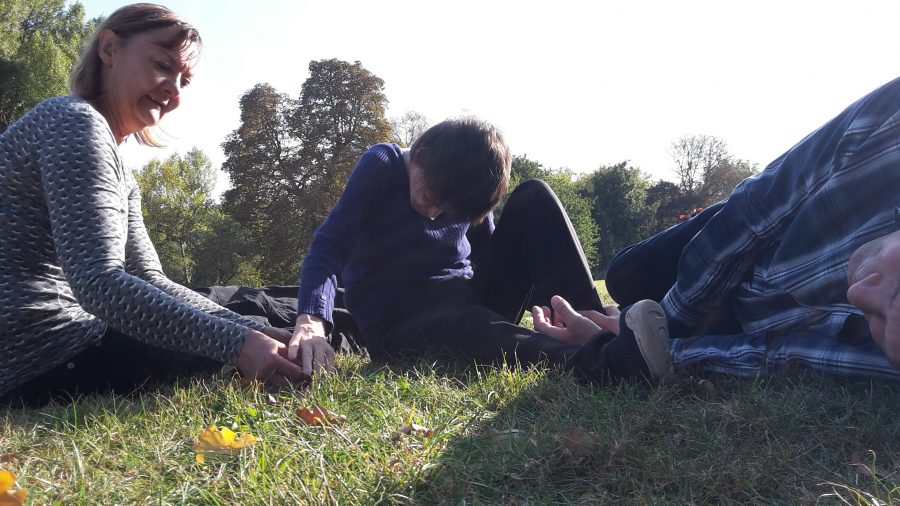 3 people on the grass
