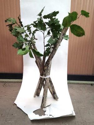 tree branches made into a vase shape