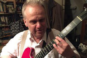 Portrait of Rikki with guitar
