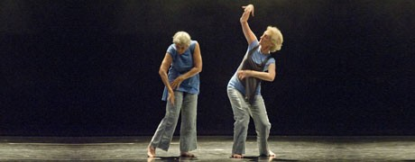 two older women dancing on stage