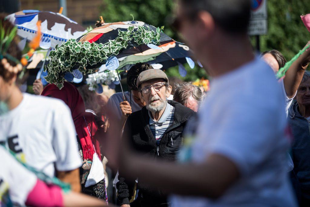 older man outside at a festival