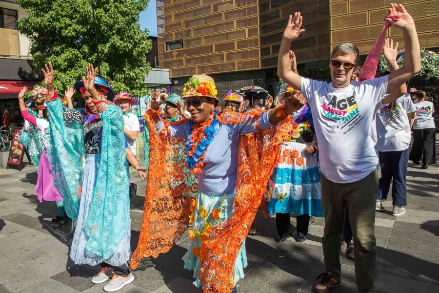 older people dressed up dancing at the festival