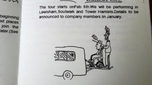 drawing of a person loading a man with a feather hat in a wheelchair into a van.
