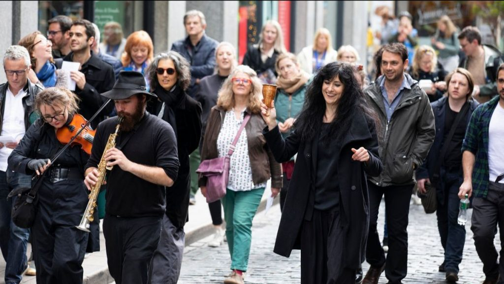 a group of people walking in the street