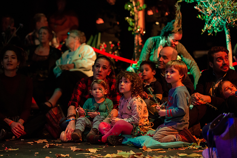 children and elders in a theatrical space