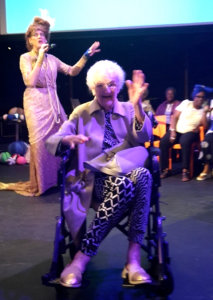 woman in wheelchair at arts event