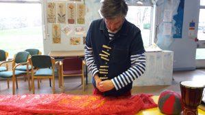 an Artist working on a wool sculpture