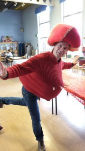 man in red jumper and hat dancing