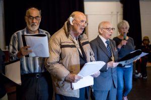 four men singing together