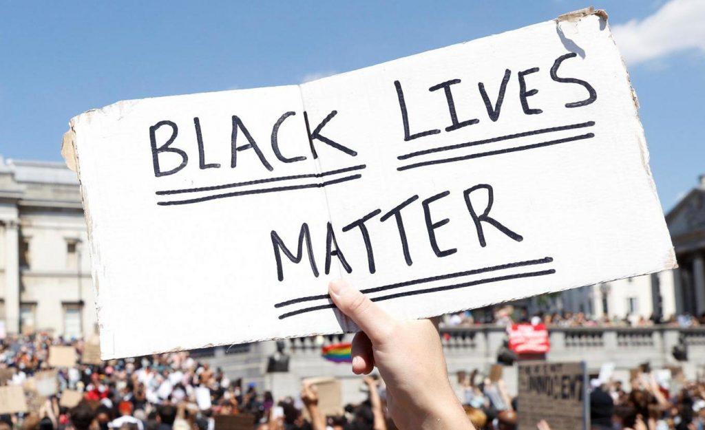 Black Lives Matter handwritten on plackard