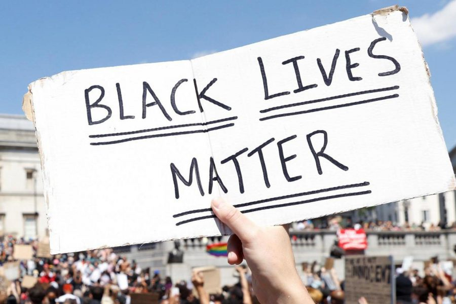 Black Lives Matter handwritten on plackard