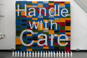 coloured bricks with text saying Handle with Care