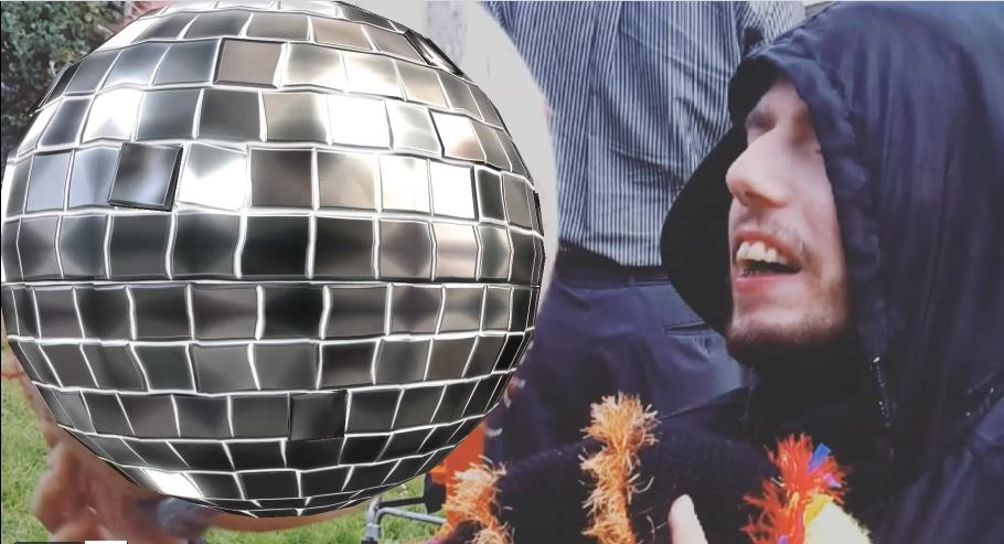 a man in a hood with a mirror ball