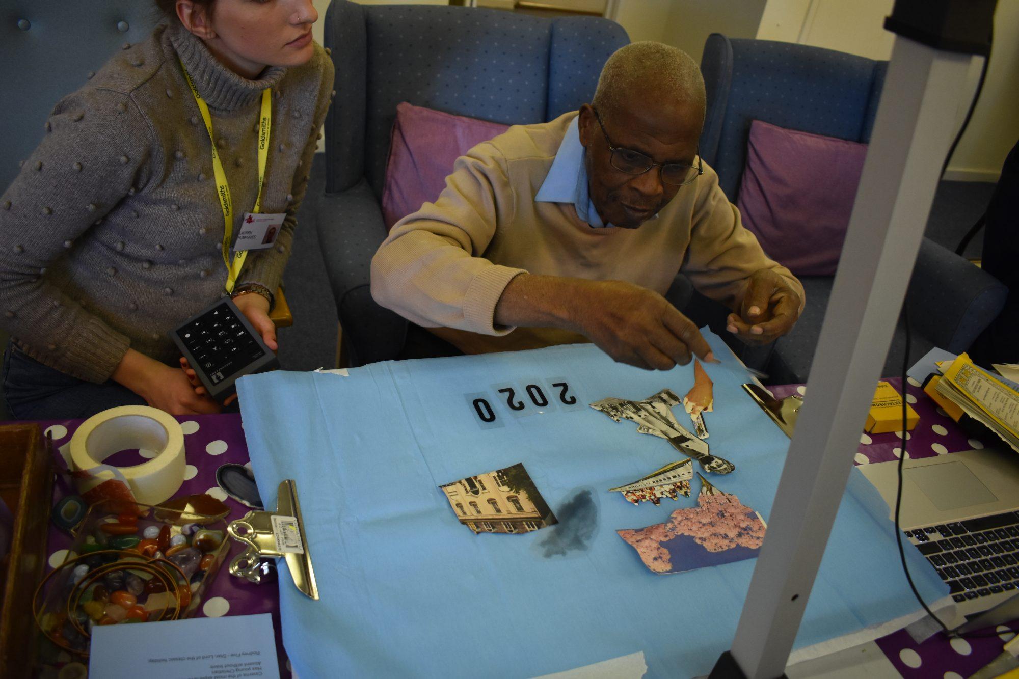 Man doing artwork at a table