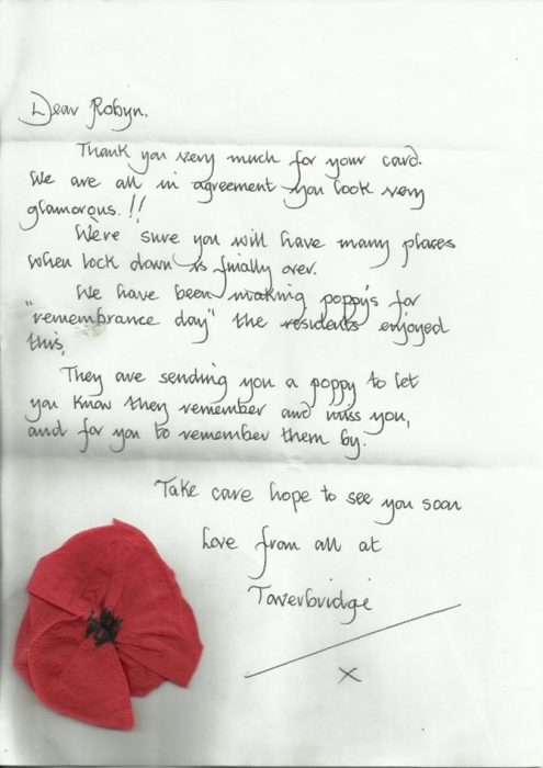 Handwritten Letter with a paper rose on it