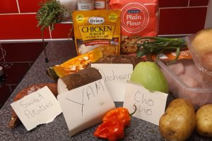 packets and vegetables on a kitchen worktop
