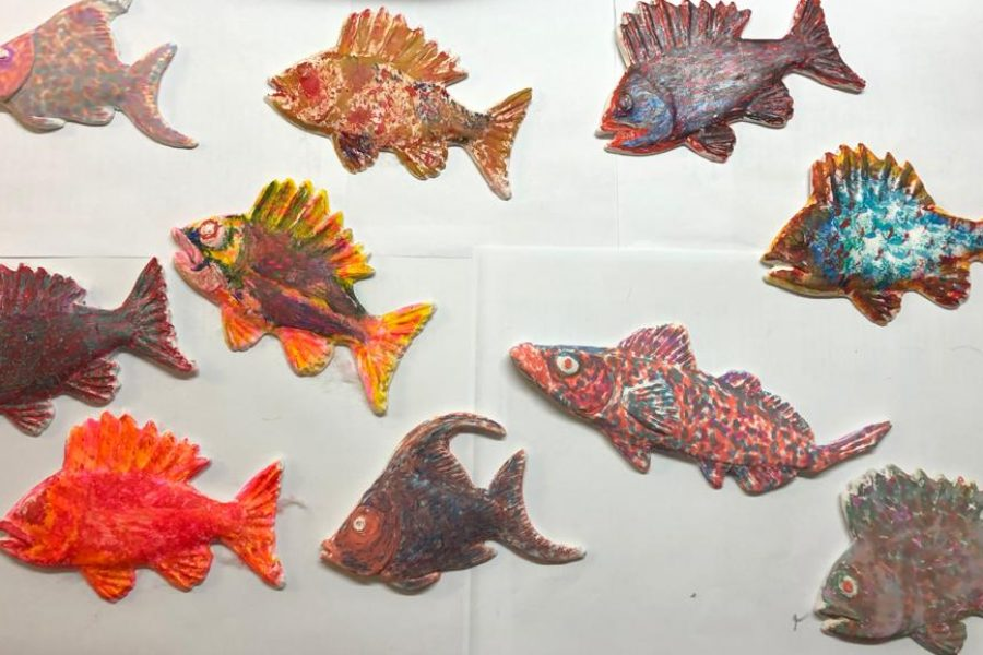 Many painted wooden fish