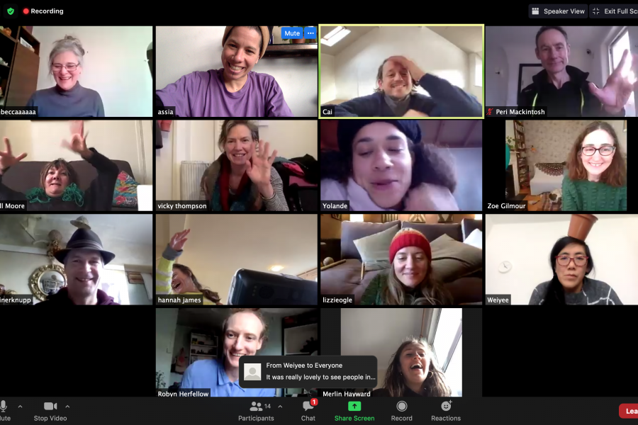 screenshot of a Zoom meeting with images of many people smiling