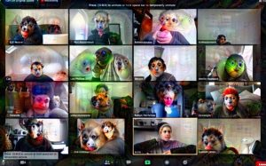sixteen people on a zoom call. their faces have been changed by the computer to look like colourful animal or alien faces.