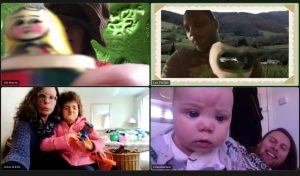 a screen shot of a zoom call between artists and participants. A man with a green landscape background, two women hugging, a baby and a man.