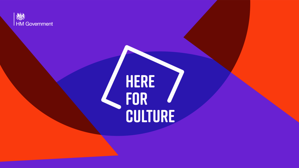 graphic image in red and purple with text Here for Culture ina white square outline.